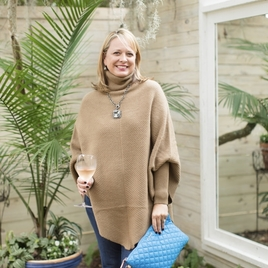 Cashmere poncho and quilted metro pouch.
